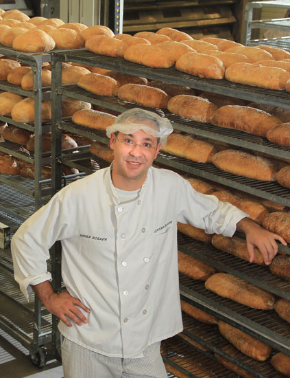 Happy Baker Standing Near Tray With Bread At The Bakery Stock ...